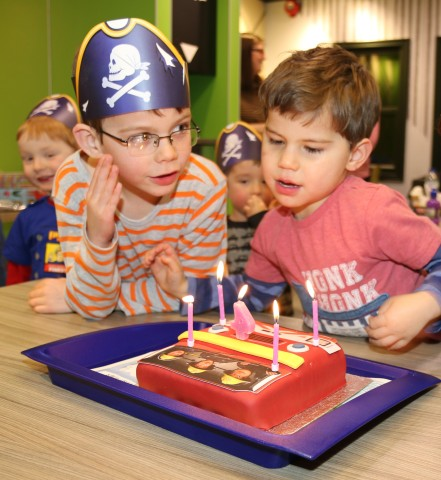 The birthday boy (right) poised to blow out his candles