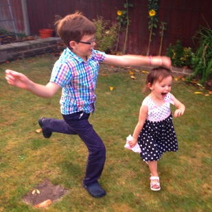 Isaac and Kara playing in the garden