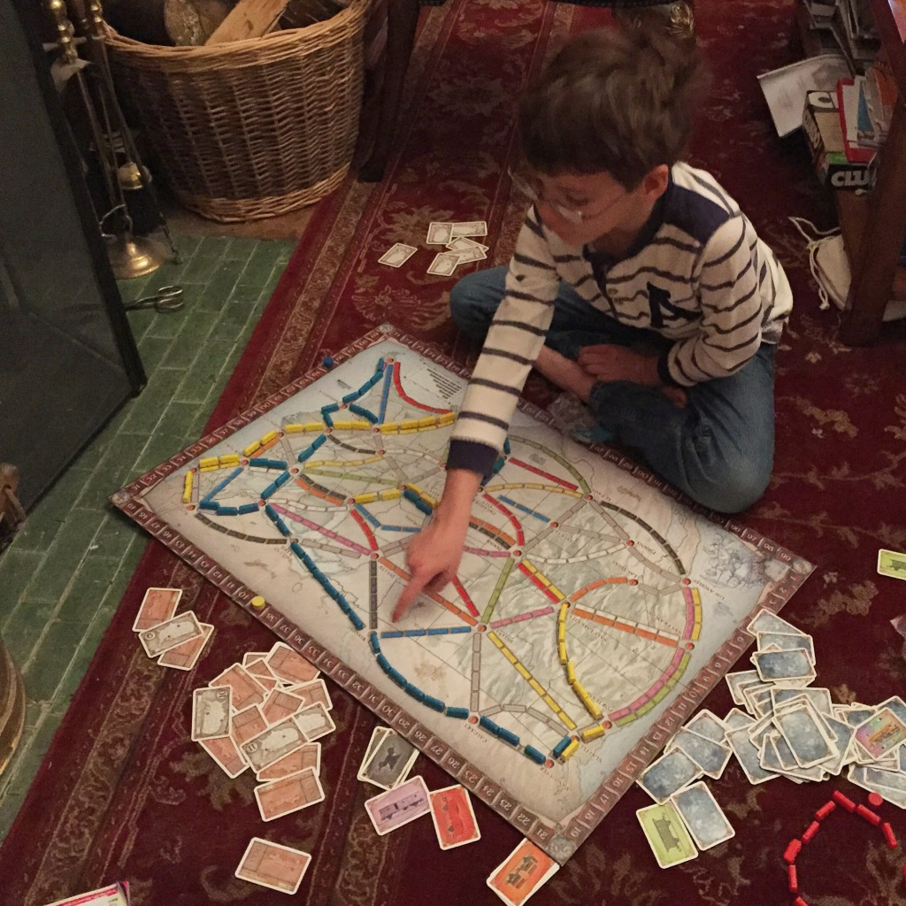 Isaac playing Ticket to Ride
