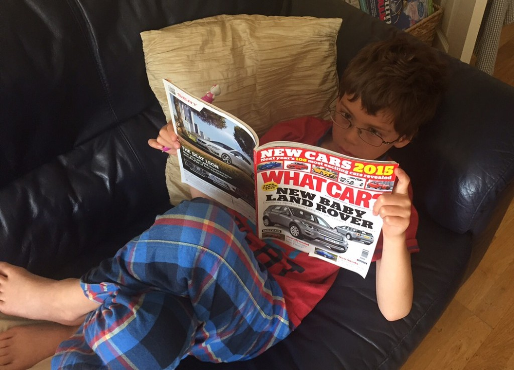 Isaac reading What Car
