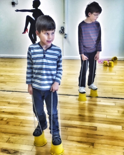 Toby Isaac stilt walking