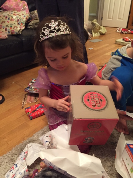 Princess Kara unwrapping disco ball