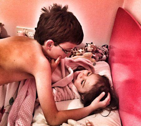 Isaac cuddling Kara