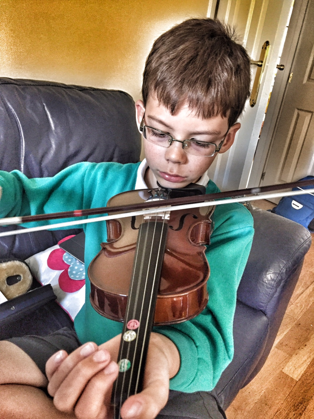 Isaac playing the viola