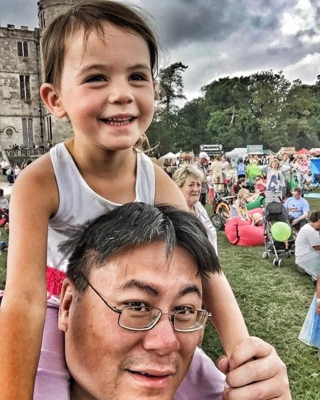 Camp Bestival Kara on daddy's shoulders