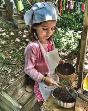 Kara making mudpies