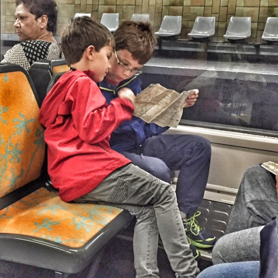 Paris boys checking metro map