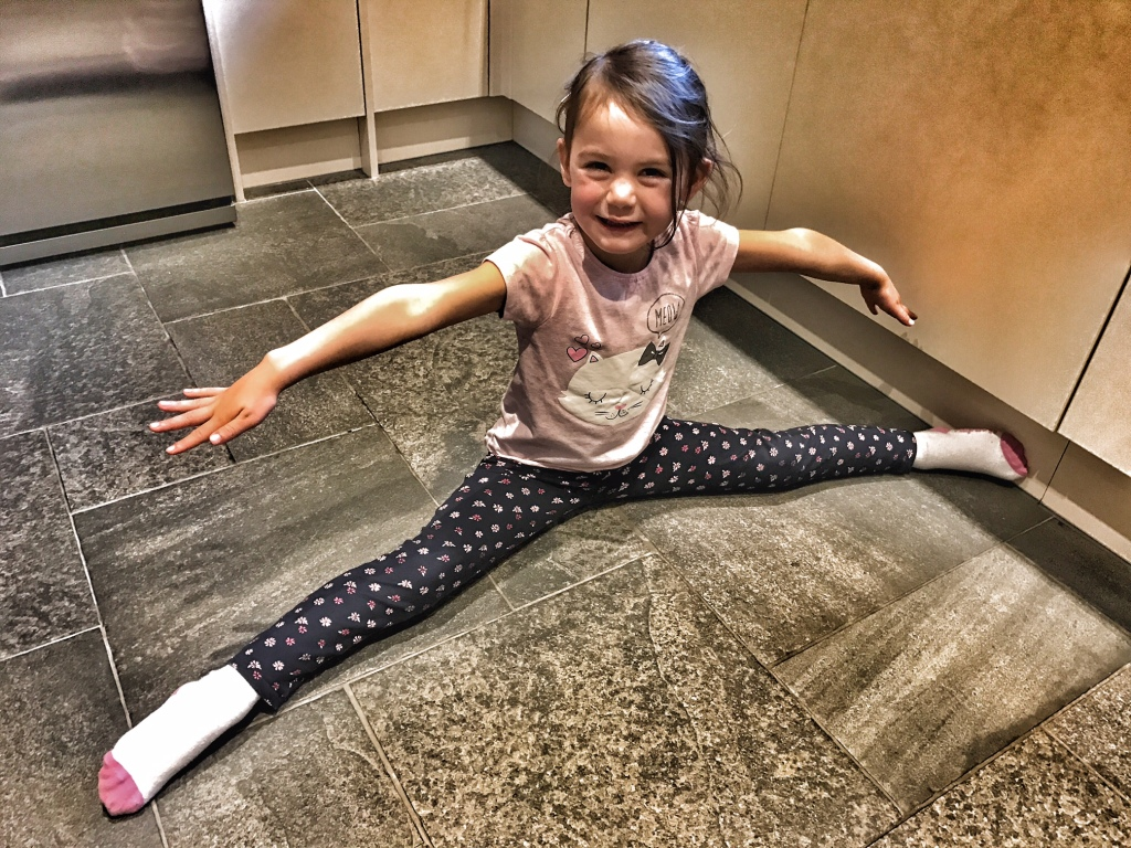 Kara shows off her gymnastics skills by doing the splits